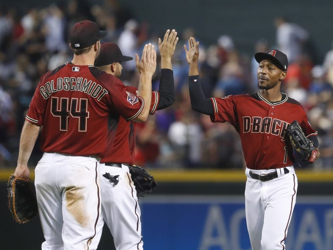 The Diamondbacks' Jarrod Dyson (1) high-fives Deven