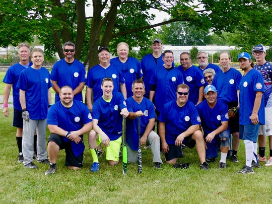 Members of the IPS men's rec softball team, celebrating its 40th season in Redford, include: (front row, from left) Dave Kerr, Mike Szybisty, Rob Scherer, Conrad Szybisty and Joe Carrier; (back row, from left) Tim Kubera, Mike Harris, Ron Hymes, Mike Franz, Paul Bonkowski, Pete Graef, Mike Mardiros, Joe Santana, John Szybisty, Mark Azzopardi, Matt Nalepinski, Mike Kohn and Justin Koehler. Not pictured are Fran DePlanche, Bob Brown, Brian Lister and Pat Shugart.