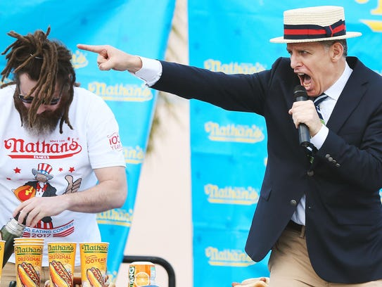 George Shea hosts a Nathan's Famous hot dog eating