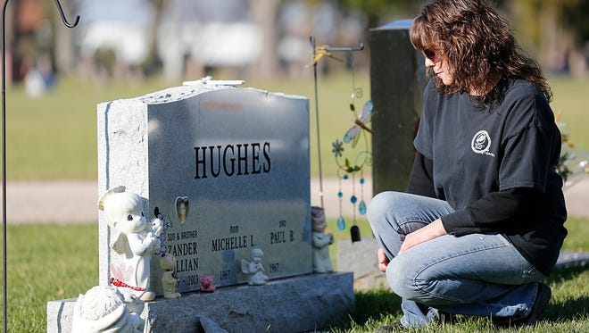 Pam Smith visits her nephew Zander's grave in Calvary Cemetery on Nov. 10, 2015.