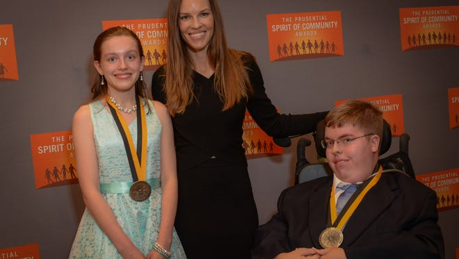 Parker Inks, right, and Meagan Warren, left, with actress Hilary Swank.