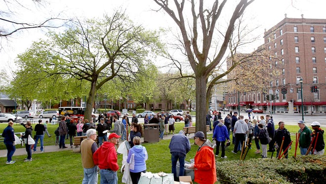 Hundreds gathered Saturday in downtown Elmira to rid the streets of garbage during Elmira Downtown Development's annual Downtown CleanUp.