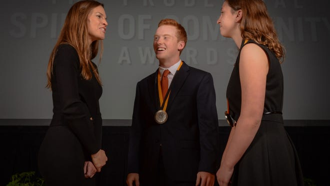 Luke Pitsenbarger (center) and another recipient speak to Hillary Swank at the Prudential Spirit of Community Awards in Washington DC.