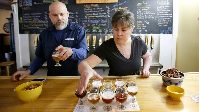 Marty and Natalie Mattrazzo fill a Taste of the Farmhouse order at their Owego brewery Thursday.