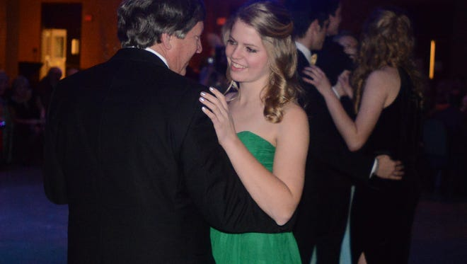 Mary Claire Hatch dances with her father at the Jackson Symphony's 2014 Crystal Ball, Saturday, January 25, 2014 at the Carl Perkins Civic Center.