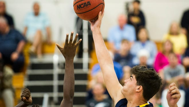Naples High School's Aiden Hancock grabs tips the ball at the Class 7A-District 12 championship at Barron Collier High School on Friday, February 16, 2018.
