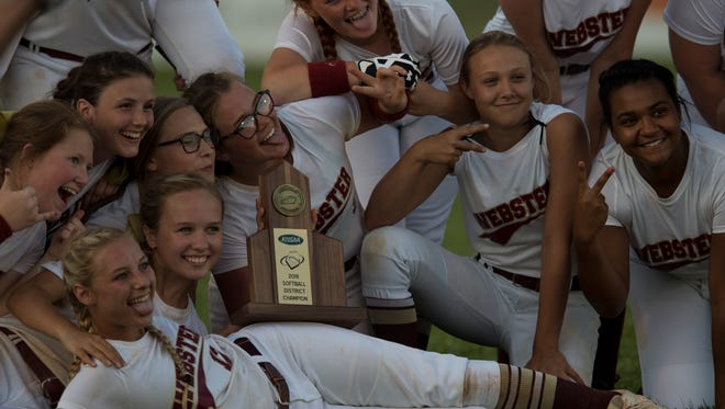 Webster's team poses with their trophy after the district softball final at Webster County High School on Thursday, May 24, 2018. Webster County defeated Henderson County 3-0.