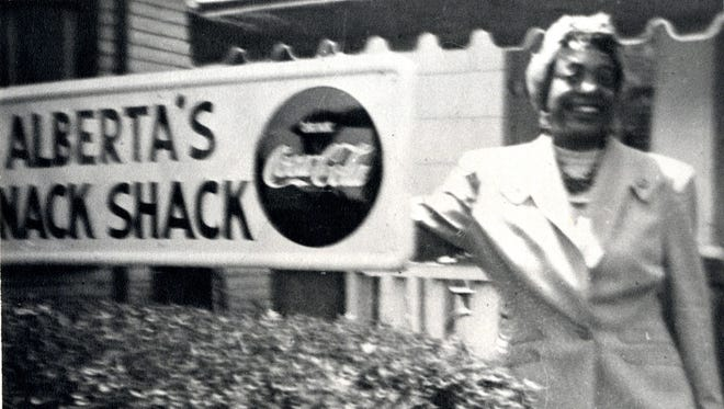 In this undated photo, entrepreneur Alberta Ellis stands outside her Benton Avenue Snack Shack business. Ellis also owned a hotel and a farm west of Springfield, which catered to African-American Route 66 travelers.
