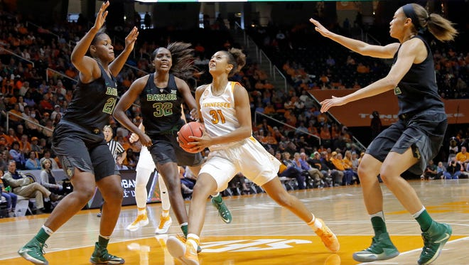 Tennessee's Jaime Nared drives against Baylor's Kalani Brown (21), Beatrice Mompremier (32) and Alexis Prince, right, in the first half of Sunday's game at Thompson-Boling Arena.