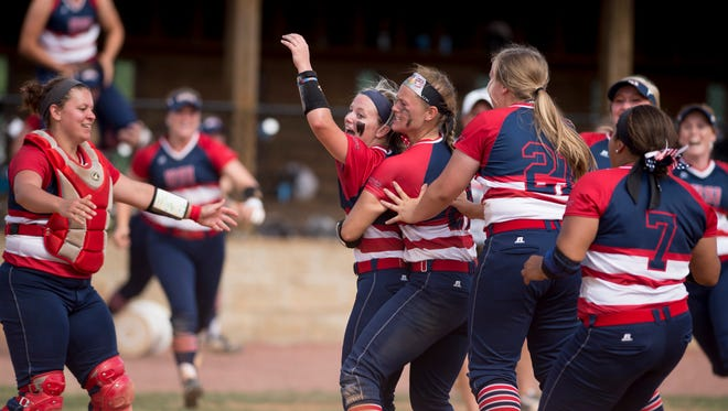 The Southern Indiana Screaming Eagles softball team celebrates after winning the 2017 NCAA Division II Midwest Super Regional at USI Softball Field.