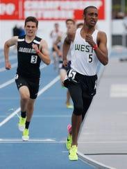 Iowa City West's Ali Ali competes in the boys 4A 3200
