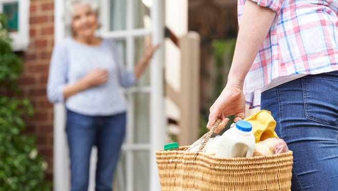 Acts of kindness include shopping for an elderly neighbor.
