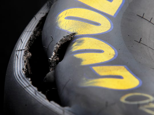 Goodyear tires sit shredded and flat by the Goodyear