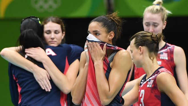 Leland native Alisha Glass reacts with teammates after losing their women's semifinal volleyball match against Serbia during the Rio 2016 Olympic Games.