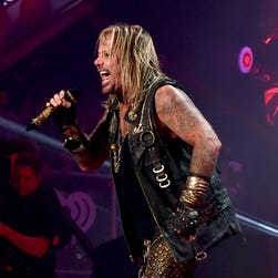 Vince Neil and Nikki Sixx of Mötley Crüe perform during the 2014 iHeartRadio Music Festival on Sept. 19, 2014 in Las Vegas. The band played its final North American show on Nov. 22, 2014, in front of an enthusiastic Spokane, Wash. crowd.