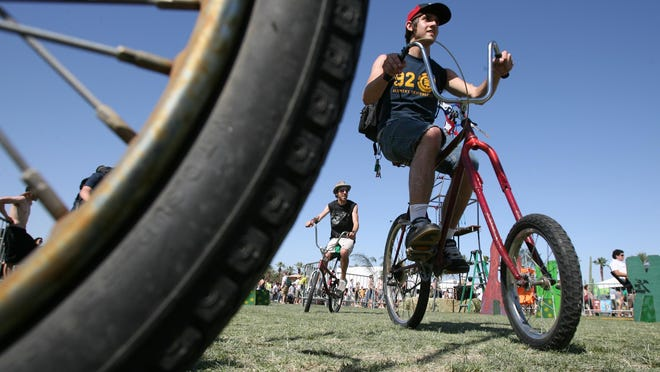 Concertgoers ride bicycles to the Coachella Valley Music and Arts Festival in Indio.