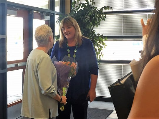 Cheryl Coyle, principal of Vado Elementary School, greets U.S. EPA Administrator Gina McCarthy with flowers from students.