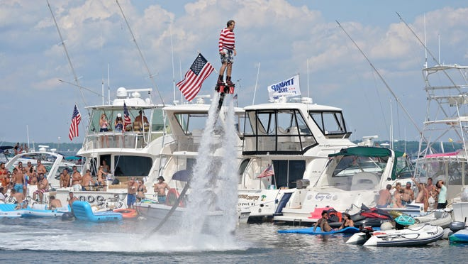 A person uses a water jet pack to get a view of the crowd at Aquapalooza.