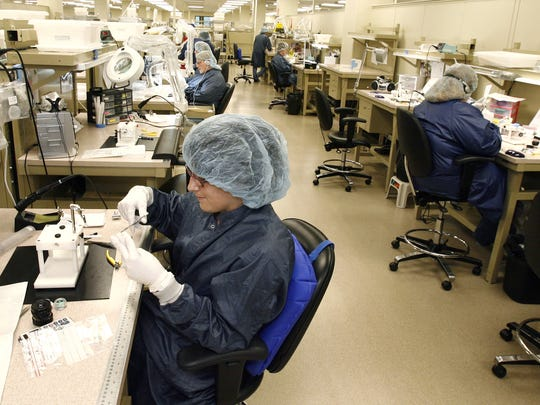 Workers are shown assembling products at a Cook Medical heart stent production area in Bloomington. A new study commissioned by BioCrossroads shows that Indiana life-sciences companies are outpacing the U.S. as a whole in several key areas, including venture capital funding, university expenditures on the industry and R&D funding.