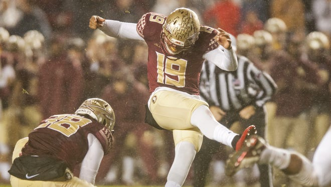 Kicker Roberto Aguayo #19 of the Florida State Seminoles kicks the game winning field goal against the Boston College Eagles during the game at Doak Campbell Stadium on November 22, 2014 in Tallahassee, Florida.
