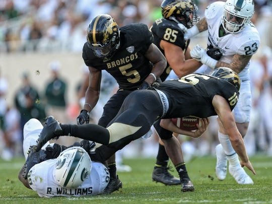 Western Michigan Broncos quarterback Jon Wassink is sacked by Michigan State Spartans defensive tackle Raequan Williams during the second half at Spartan Stadium on Sept. 9, 2017 in East Lansing.