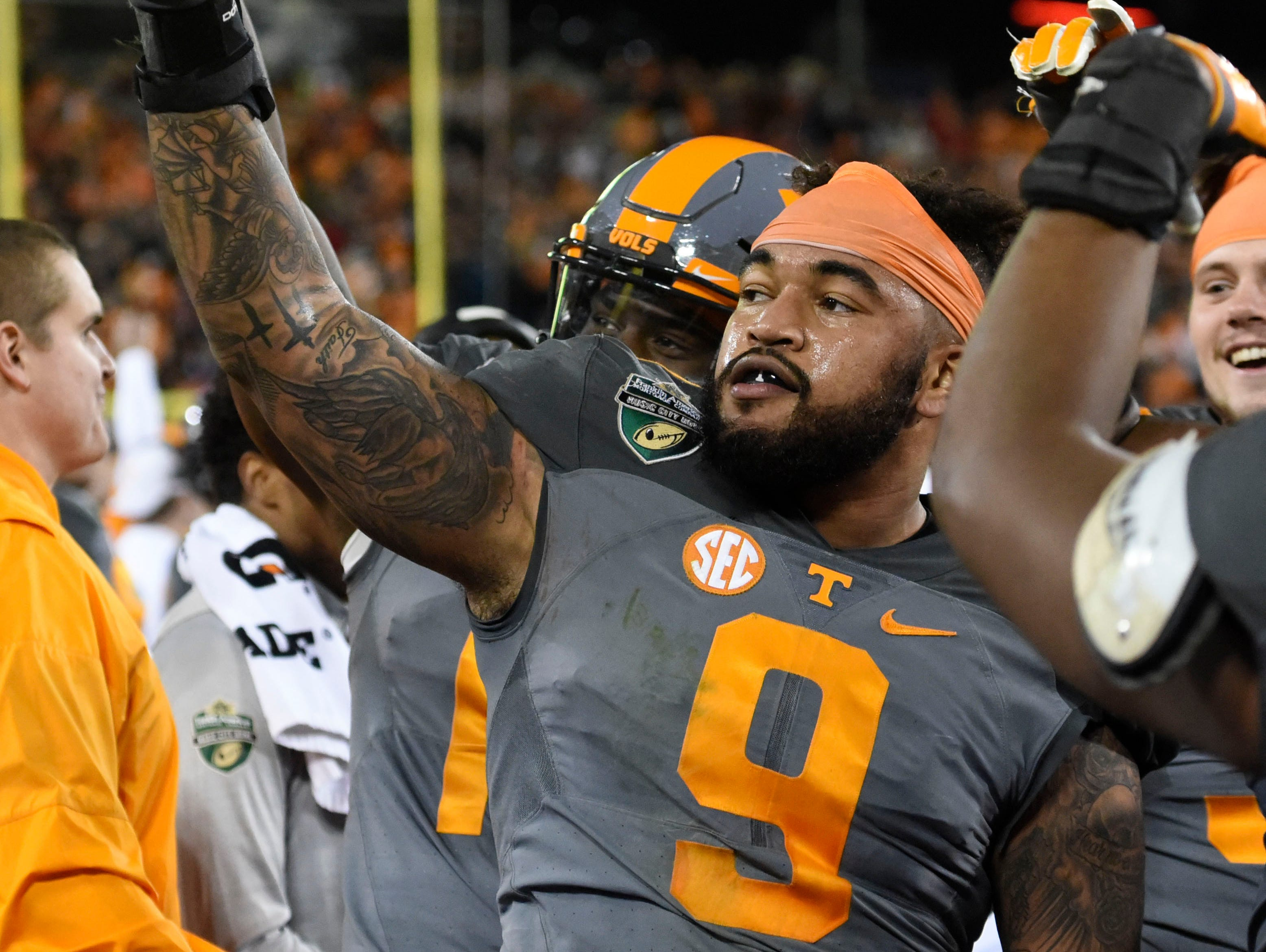 Tennessee defensive end Derek Barnett waves to fans at the end of the Franklin American Mortgage Music City Bowl on Dec. 30 in Nashville.