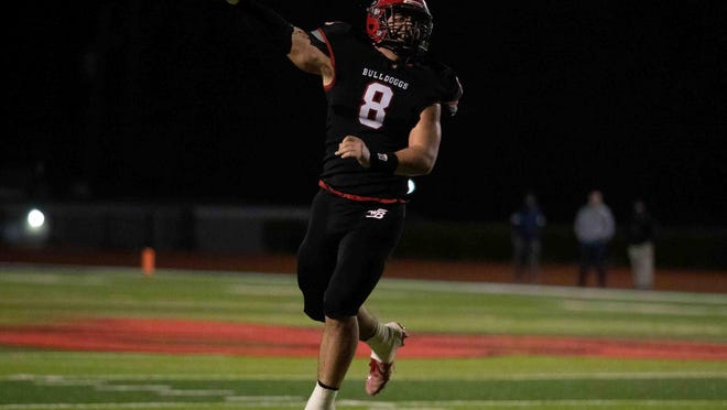 Winder-Barrow's Chandler Maxwell (8) celebrates during the Bulldoggs' 17-14 win over Lanier that qualified them for the Class 6A state playoffs.