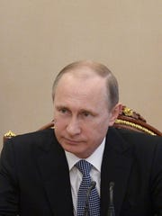 Russian President Vladimir Putin chairs a meeting of