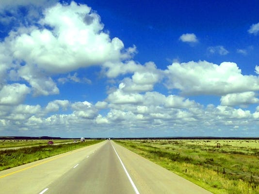 highway-open-road-blue-sky-north-dakota-getty_large.jpg