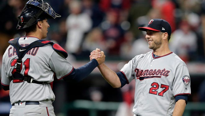 Minnesota Twins relief pitcher Brandon Kintzler, right, is congratulated by catcher Jason Castro after the Twins defeated the Cleveland Indians 1-0 in a baseball game, Friday, May 12, 2017, in Cleveland.