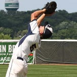 Whitnall's Andrew Mixon catches a Pius XI pop-up fly on Phillies Field at The Rock Sports Complex during the Woodland Conference Tournament on July 5. The Falcons dropped a 5-3 decision to the Popes.