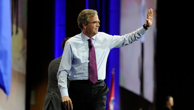 Former Florida governor Jeb Bush waves to the crowd after he speaks at the NRA convention in Nashville, on April 10, 2015.
