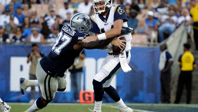 Dallas Cowboys defensive end Taco Charlton sacks Los Angeles Rams quarterback Sean Mannion during the first half of a preseason NFL football game Saturday in Los Angeles.