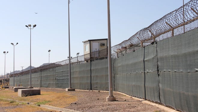 In this file photo taken on January 26, 2017, a guard tower is seen outside the fencing of Camp 5 at the U.S. military's prison in Guantanamo Bay, Cuba.
