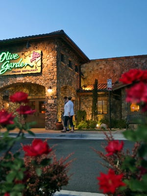 This file photo taken in 2014 shows diners entering an Olive Garden Restaurant in Short Pump, Va.