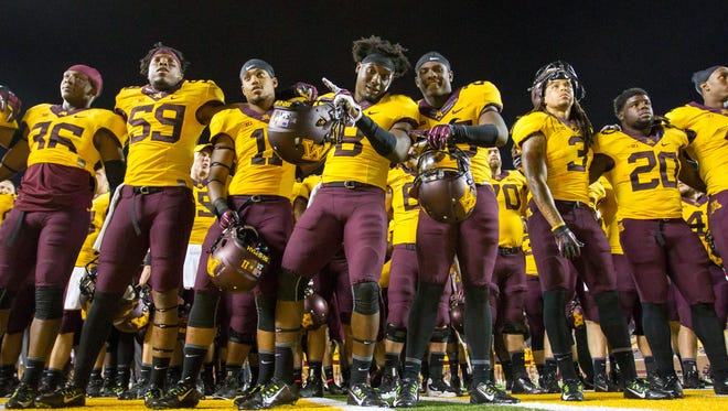 Minnesota defensive back Daletavious McGhee (8) and teammates celebrate their 42-20 win over Eastern Illinois last week. The Gophers host MTSU on Saturday.