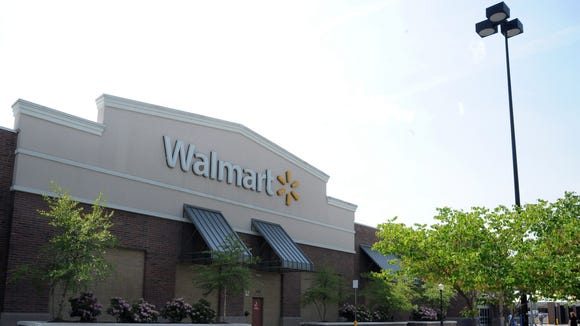 Walmarts like this one in Asheville will save tens of thousands of dollars a year under a new tax plan Gov. Pat McCrory signed into law on Thursday.