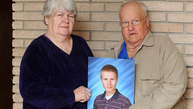 Natalie and John Lavender hold a photo of grandson Jay at their Sioux Falls home. The 16-year-old O'Gorman student was killed after being struck by a semitruck Oct. 1 on Interstate 90.