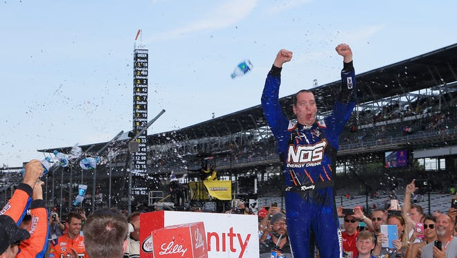 Kyle Busch celebrates after winning the Lilly Diabetes 250 Saturday at Indianapolis Motor Speedway.