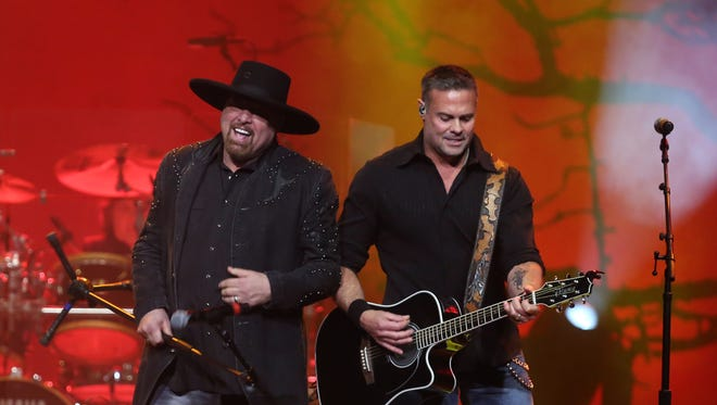 Montgomery Gentry performs during the Randy Travis tribute concert at Bridgestone Arena Wednesday, Feb. 8, 2017. Troy Gentry is pictured on the right.