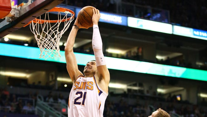 Suns center Alex Len dunks the ball against the Detroit Pistons in the first half of Tuesday night?s game at Taking Stick Resort Arena. Phoenix Suns center Alex Len slam-dunks the ball against the Detroit Pistons in the first half on Mar. 20, 2018 at Taking Stick Resort Arena in Phoenix, Ariz.
