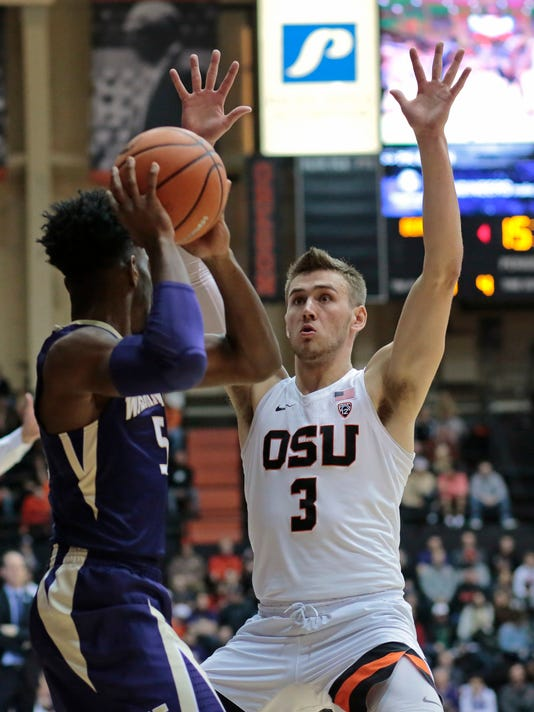 Oregon State's Tres Tinkle (3) pressures Washington's Jaylen Nowell (5) during the first half of an NCAA college basketball game in Corvallis, Ore., Saturday, Feb. 10, 2018. (AP Photo/Timothy J. Gonzalez)