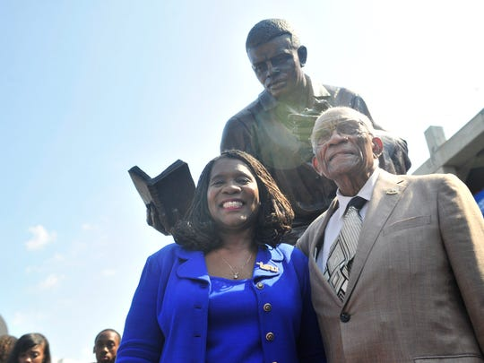 TSU President Glenda Glover stands with legendary TSU track coach Ed Temple as he has his likeness preserved during a statue unveiling by First Tennessee Park on Aug. 28, 2015. Temple had 40 of his runners in the Olympics, 23 won medals and 100 percent of his Olympic runners graduated.