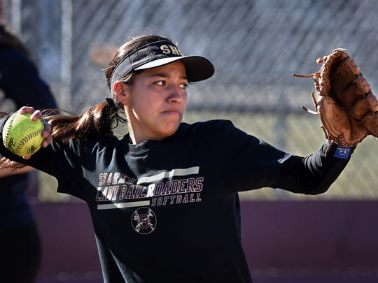 Sparks softball player Angie Hurtado winds up to throw the ball during practice at Sparks High School softball field on March 25, 2018.