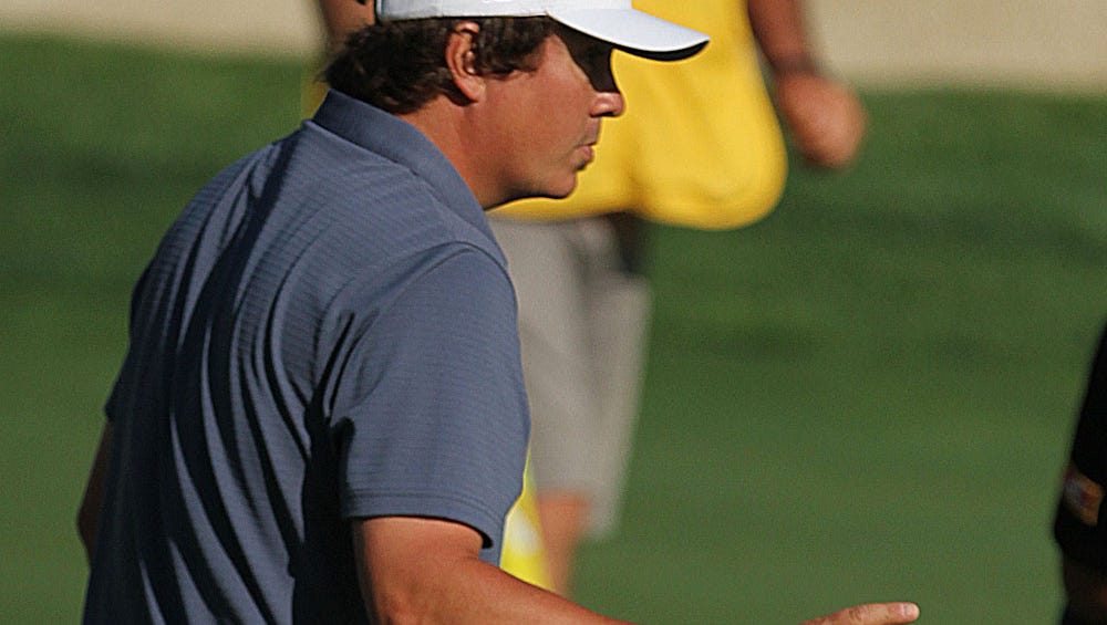 Jason Dufner acknowledges the crowd after sinking a putt Thursday. Photo by Tina Yee