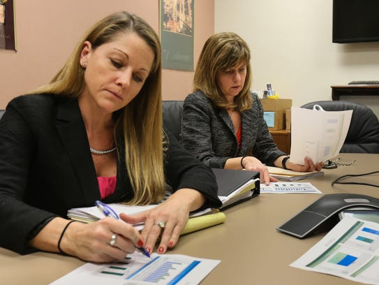 Jen Donahue, left, child abuse investigator for the