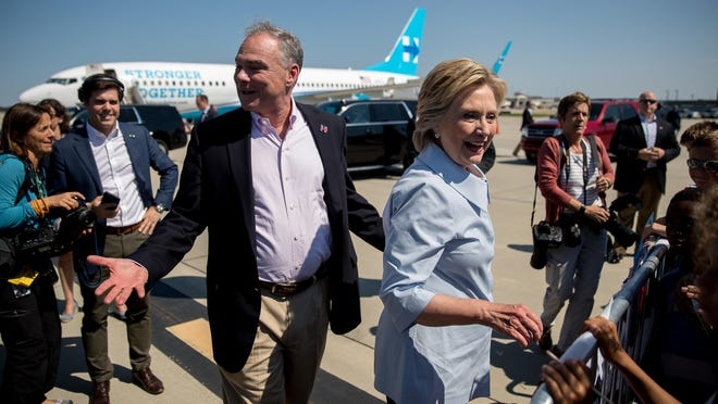 Democratic presidential candidate Hillary Clinton, center right, and Democratic vice presidential candidate, Sen. Tim Kaine, D-Va., center left, greet members of a crowd as Clinton arrives at Cleveland Hopkins International Airport in Cleveland, Ohio, Monday, Sept. 5, 2016, after traveling from Westchester County Airport in White Plains, N.Y.
