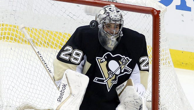 Pittsburgh Penguins goalie Marc-Andre Fleury (29) makes a save against the Columbus Blue Jackets during the second period in game five of the first round of the 2014 Stanley Cup Playoffs at the CONSOL Energy Center.