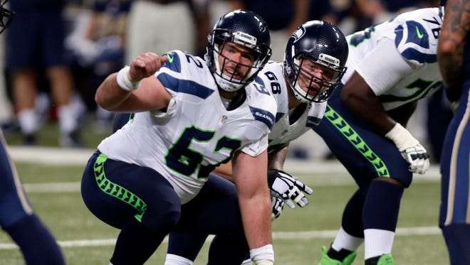 Seattle Seahawks center Drew Nowak prepares to snap the ball during the second quarter of an NFL football game against the St. Louis Rams Sunday, Sept. 13, 2015, in St. Louis.