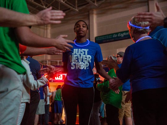 FGCU's Tytionia Adderly high fives fans as the team